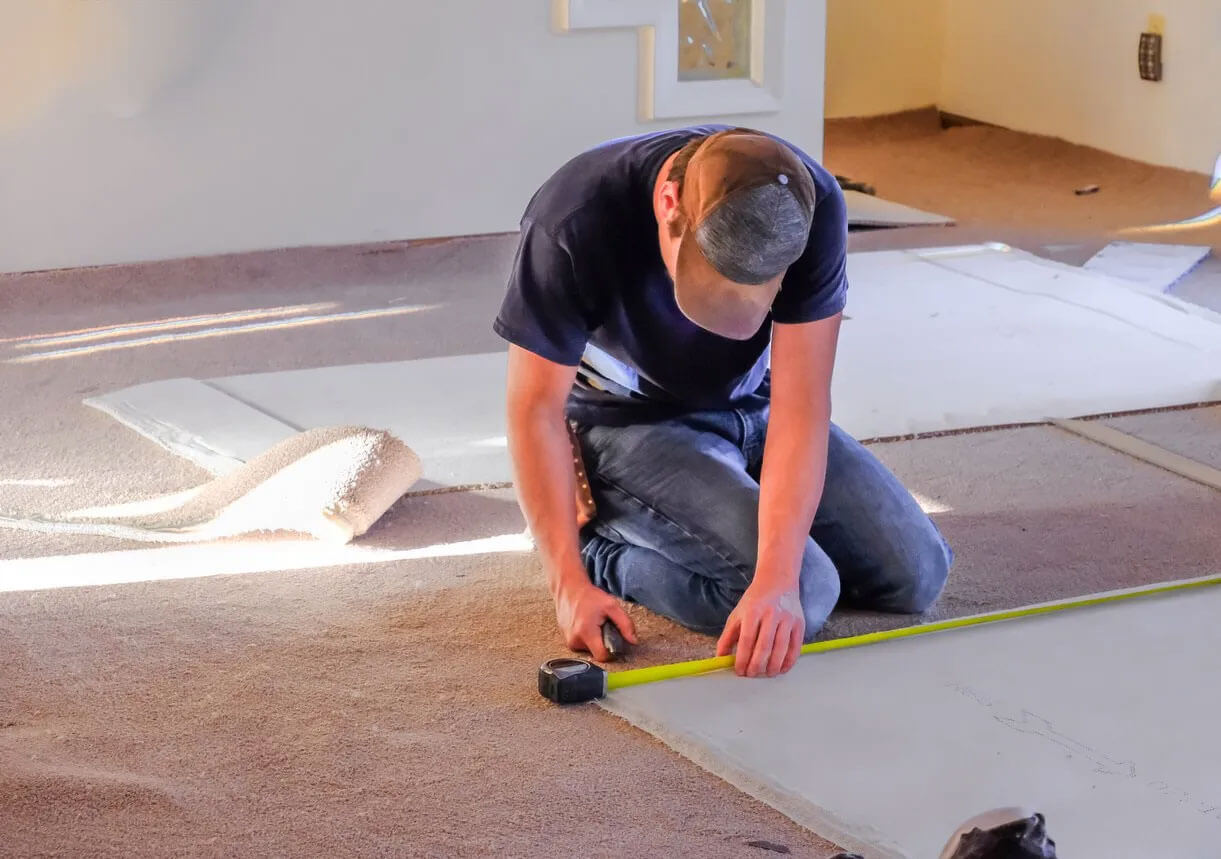 This technician is doing a carpet repair in Raleigh, NC