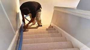 Residential carpet cleaning in Raleigh, NC on a set of stairs